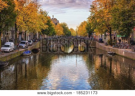 Amsterdam Netherlands - October 30 2016: The canal Oudezijds Voorburgwal in the Red light District of the old center of Amsterdam