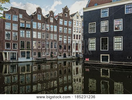 The canal houses along the junction of the canals Oudezijds Voorburgwal and Oudezijds Achterburgwal in the old center of Amsterdam