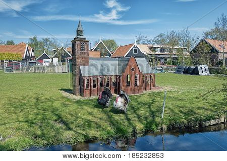 Luxury chicken coop in the form of a cathedral for the believing poultry.