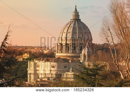 Basilica of Saint Peter, Rome. Italy. Fabulous photograph of the dome of St. Peter's Basilica in Rome in Italy. Photo taken from the Gianicolo Terrace. Antiqued colors. Sunset lights.