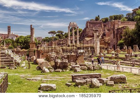 ROME, ITALY - MAY 10, 2014: Roman Forum in summer day. The Roman Forum is an important monument of antiquity and is one of the main tourist attractions of Rome.