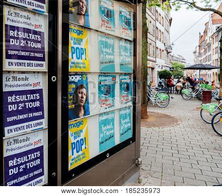 STRASBOURG FRANCE - MAY 7 2017: Election results in France Le Monde poster in press kisok and city perspective during the second round of the French presidential election to choose between Emmanuel Macron and Marine Le Pen