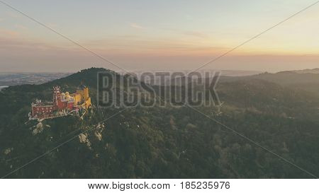 Aerial panorama of colorful Palacio da pena castle,Pena National Palace,Sintra, Lisbon, Portugal, Europe.Royal castle.UNESCO World Heritage Site and Wonder of Portugal.Travel Europe,European places