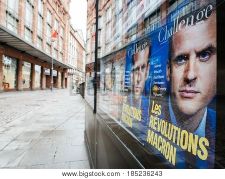 STRASBOURG FRANCE - MAY 7 2017: French city with Macron revolution cover magaizne press kiosk with city in background during the second round of the French presidential election to choose between Emmanuel Macron and Marine Le Pen