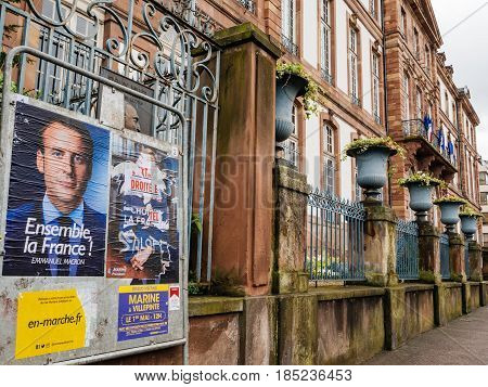 STRASBOURG FRANCE - MAY 7 2017: French city-hall with vandalized Marine Le Pen poster ready for second round of the French presidential election to choose between Emmanuel Macron and Marine Le Pen