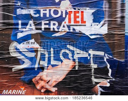 STRASBOURG FRANCE - MAY 7 2017: Vandalized Marine Le Pen campaign poster with Salope word near polling place during the second round of the French presidential election to choose between Emmanuel Macron and Marine Le Pen