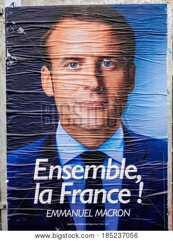 STRASBOURG FRANCE - MAY 7 2017: Emmanuel Macron portrait poster detail next to polling place during the second round of the French presidential election to choose between Emmanuel Macron and Marine Le Pen