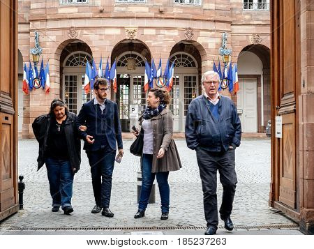 STRASBOURG FRANCE - MAY 7 2017: French city with family leaving polling place during the second round of the French presidential election to choose between Emmanuel Macron and Marine Le Pen