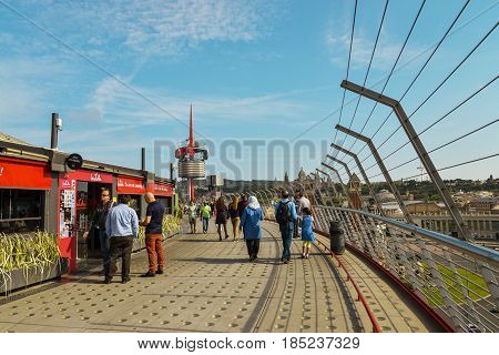 BARCELONA SPAIN - April 15 2017: Peoples walking on roof of Arenas de Barcelona in Barcelona Spain. The old bullring built in 1900 is since 2011 after an intense remodeling a shopping and leisure center.