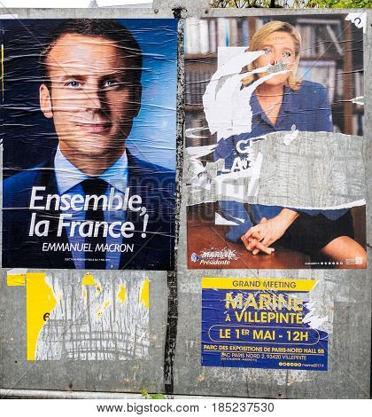 STRASBOURG FRANCE - MAY 7 2017: French city with vandalized Le pen poster newar poling place during the second round of the French presidential election to choose between Emmanuel Macron and Marine Le Pen