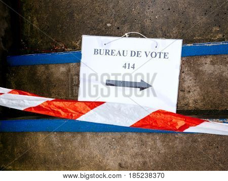 Bureau de vote Poling statin sign on floor near pooling place during the second round of the French presidential election to choose between Emmanuel Macron and Marine Le Pen