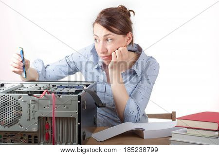 Woman looking confused to hardwear on a white background