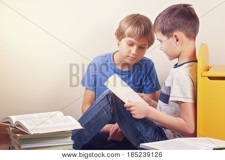 Kids sitting and reading books at home
