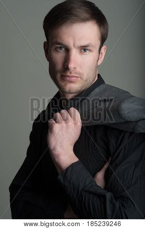 Portrait of a handsome businessman with a jacket on his shoulder