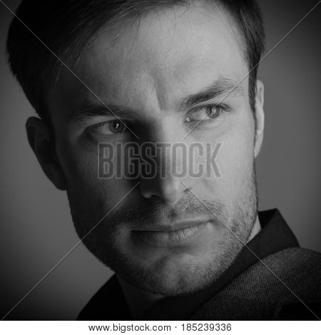 Portrait of a businessman who looks away