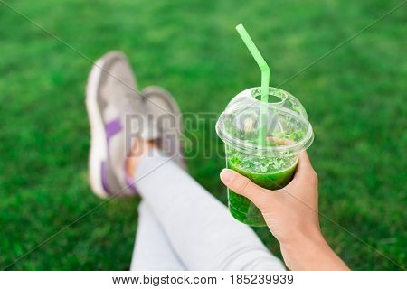 Young woman drink green smoothie healthy detox