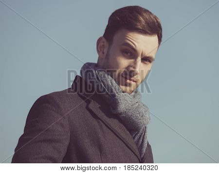 Man Or Fashion Model In Coat, Scarf On Blue Sky