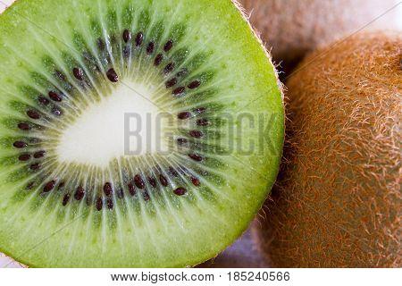 Fresh kiwi fruit flesh closeup. Shallow depth of field.