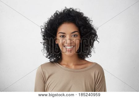 Cheerful Dark-skinned Girl Smiling Broadly, Rejoicing At Her Victory In Competition Among Young Writ