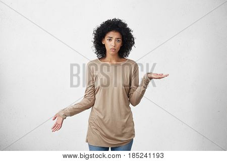 Cueless Puzzled Dark-skinned Girl Gesturing With Hands In Ignorance And Confusion, Shrugging Shoulde