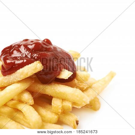Pile of a potato french fries with some ketchup sauce poured over it, close-up crop composition isolated over the white background