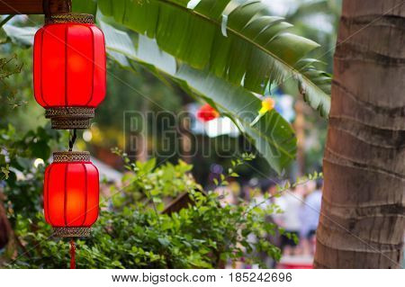 Barrel-shaped Chinese double red lantern in the early evening