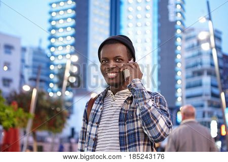 Cheerful Charismatic Young Afro American Student In Stylish Wear Smiling Happily While Having Phone