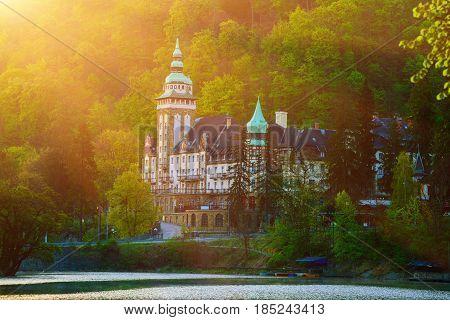 Lillafured palace in Miskolc, Hungary with sun shining. Lake Hamori in foreground. Travel outdoor hipster landmark background