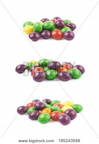 Pile of colorful chewing candies isolated over a white background, set of three different angles.