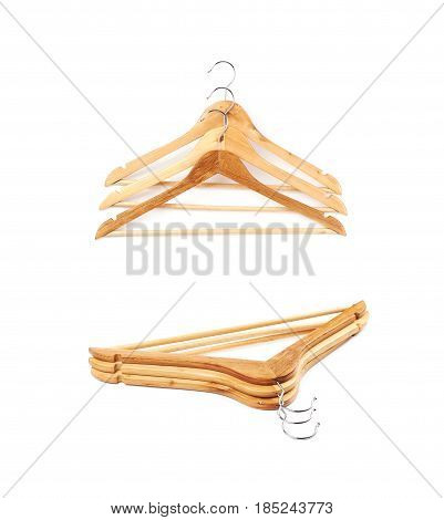 Pile of light wooden hangers isolated over a white background, set of two different angles.