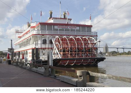 Savannah, Georgia, USA - January 20, 2017: The historic Georgia Queen riverboat docked on the the Savannah River on the Riverwalk on River Street