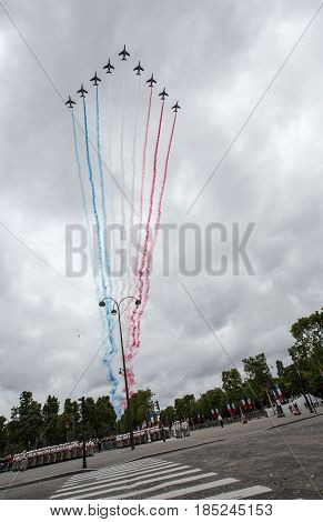 Paris France - July 14 2012. Alpha jets from Patrouille de France fly over the Champs Elysees on the Day of the Bastille.