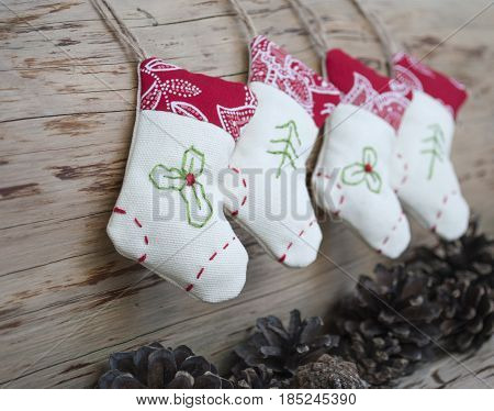 Christmas socks hanging on the white woodwall