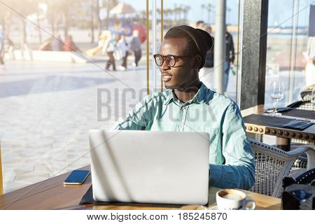 Urban Lifestyle, Modern Technologies And Online Communication. Carefree Black European Male Relaxing