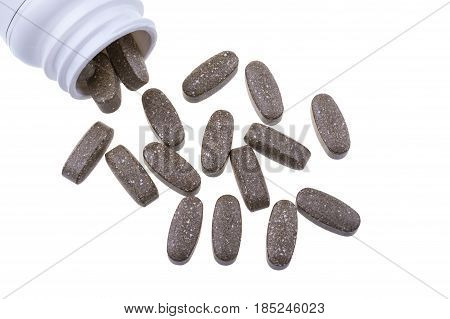Multivitamin herbal pills isolated on white background.