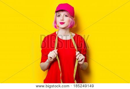 Young Woman With Centimeter