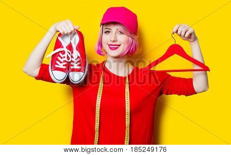 Young Woman With Centimeter, Gumshoes And Hanger