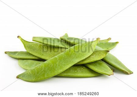 Green peas (Pisum sativum) isolated in white background