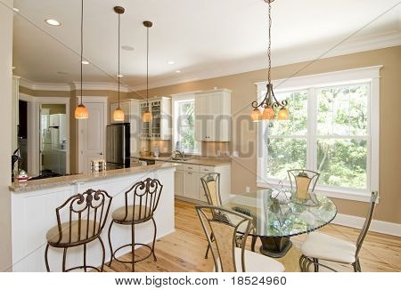 expensive kitchen and dining room area