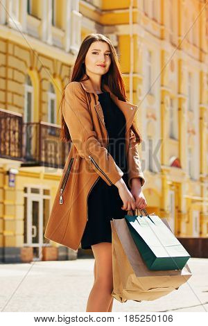 Shopping Beauty. Portrait Of Beautiful And Happy, Fashionable Young Girl Holding Shopping Bags While