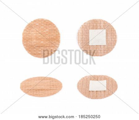 Adhesive bandage sticking plaster isolated over the white background, set of four different foreshortenings