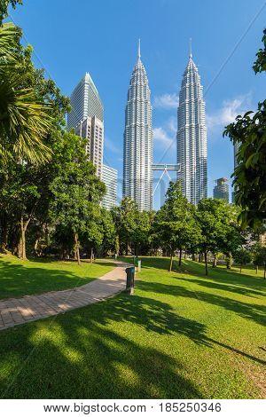 Kuala Lumpur, Malaysia - September 24, 2016: Petronas towers and green park in Kuala Lumpur, Malaysia
