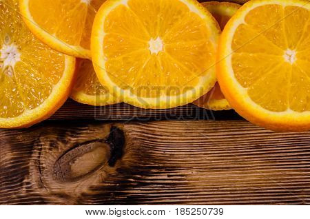 Orange Slices On Wooden Table. Top View