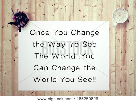 Inspiring motivation quote handwritten on a notepad  once you change the way to see the world...you can change the world you see. White pad paper image.