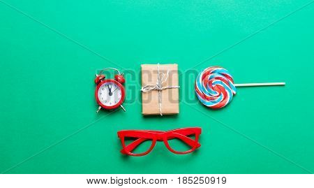 Gifts, Glasses, Lollipop And Alarm Clock
