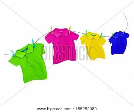 Laundry line with colored t-shirts on a white background