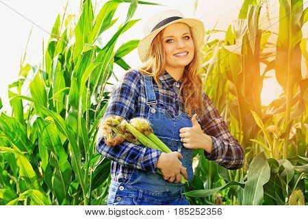 Good Harvest. Portrait Of Young And Beautiful Smiling Girl In Hat And Coveralls Showing Big Thumb Up