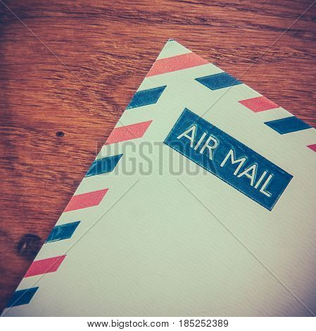 Retro Photo Of An Old Air Mail Envelope Of A Rustic Wooden Background