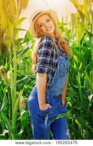 Farmer Fashion. Portrait Of Beautiful And Young, Attractive And Smiling Red Haired Girl In Hat And C
