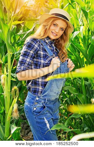 Farmer Fashion. Portrait Of Beautiful And Young, Attractive Red Haired Girl In Hat And Coveralls Pos